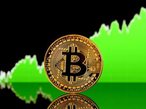 Bitcoin standing in front of a green chart